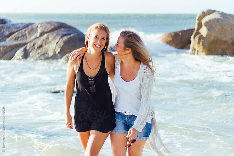 Two Girls on the Beach by Hillary Fox for Stocksy United