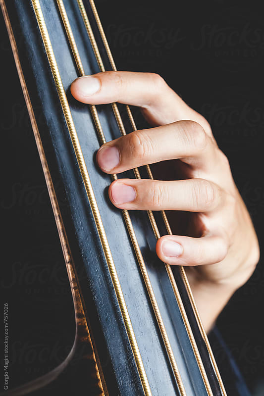 Hand Performing on a Double Bass by Giorgio Magini for Stocksy United