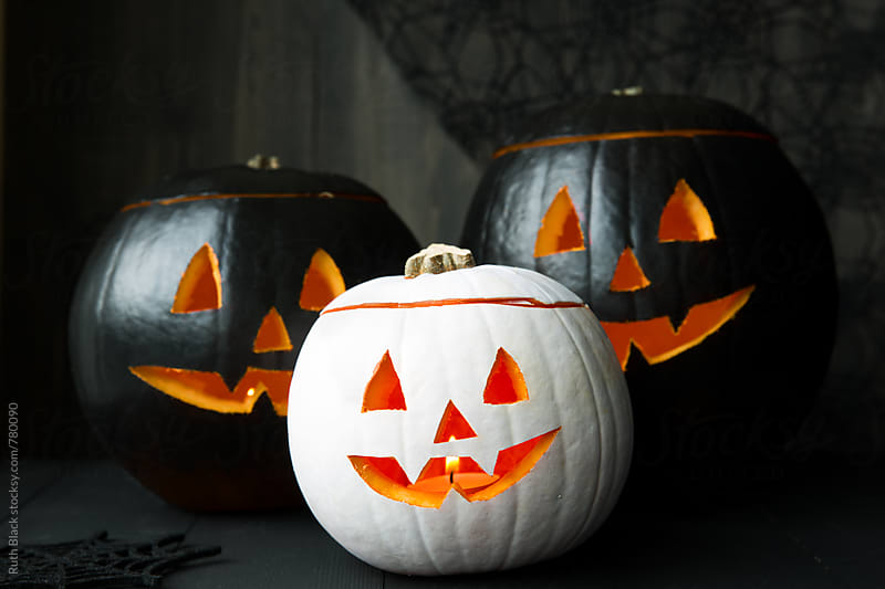 Black and white painted jack o lanterns by Ruth Black for Stocksy United