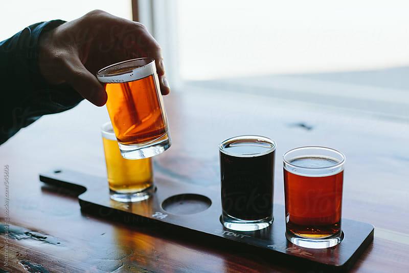 Sampling micro brew beer at brewery by Matthew Spaulding for Stocksy United