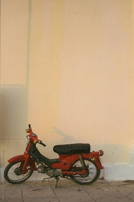 Old Red Motorcycle On the Street by Brkati Krokodil for Stocksy United