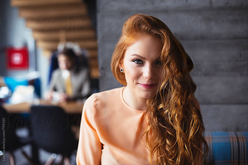 Ginger Woman in a Bar by Lumina for Stocksy United