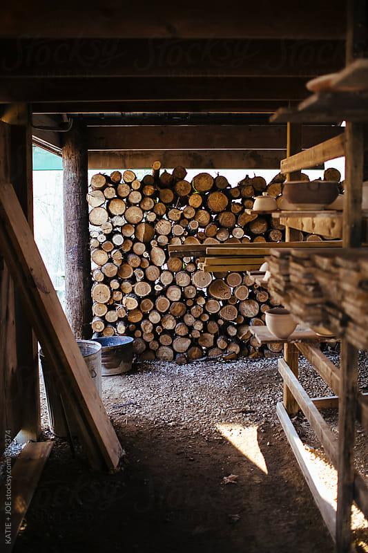 Log Pile by KATIE + JOE for Stocksy United