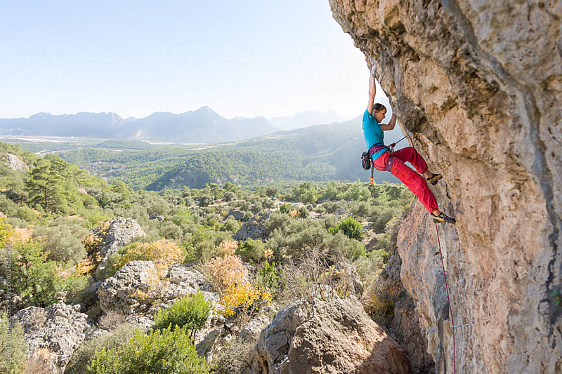 Young woman rock climbing in a wonderful natural landscape by RG&B Images for Stocksy United