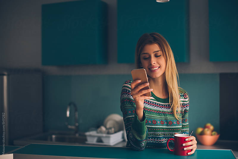 Young Woman Using Smartphone at Home by Mosuno for Stocksy United