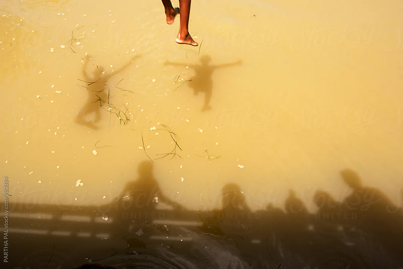 Boys jumping in water in summertime by PARTHA PAL for Stocksy United