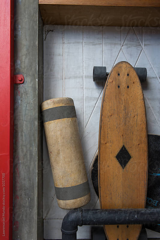 Skateboard and floater detail inside a coffee shop by Lawrence del Mundo for Stocksy United