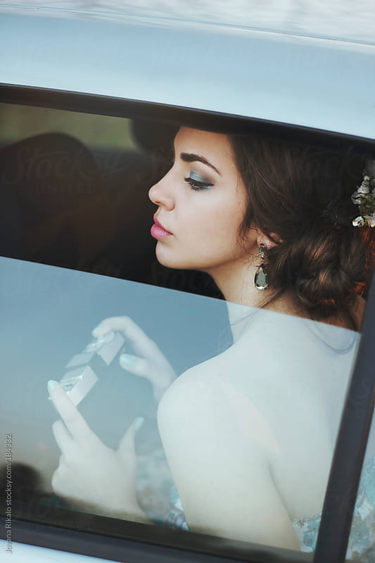Portrait of a beautiful young woman sitting in a car by Jovana Rikalo for Stocksy United