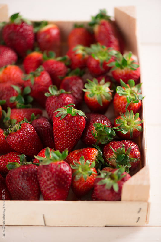 strawberries in a woodden box by Laura Adani for Stocksy United