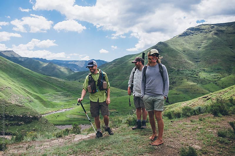 Hikers taking a break in green mountainous valley by Micky Wiswedel for Stocksy United