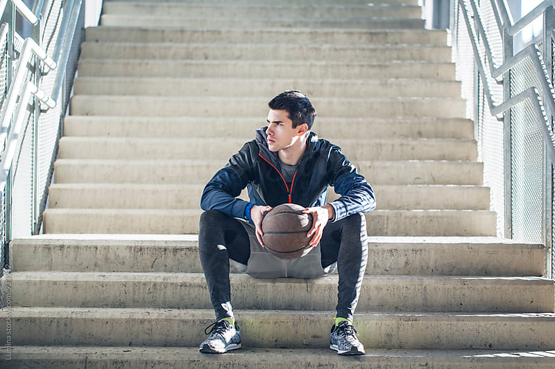 Basketball Player Taking a Break  by Lumina for Stocksy United