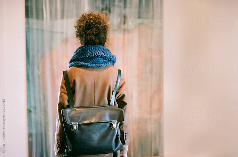 Back view of the girl with a backpack by Lyuba Burakova for Stocksy United