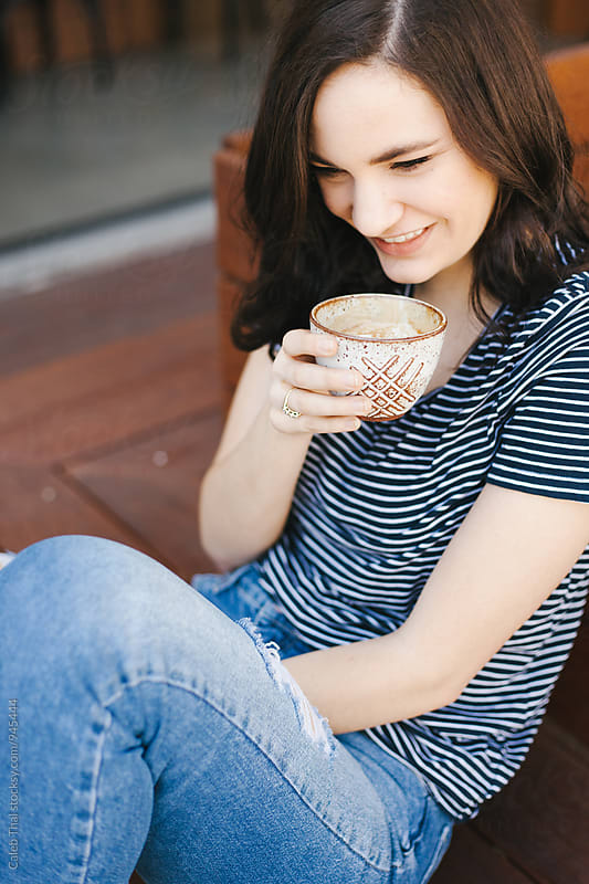 Pretty Woman Drinking Coffee by Caleb Thal for Stocksy United