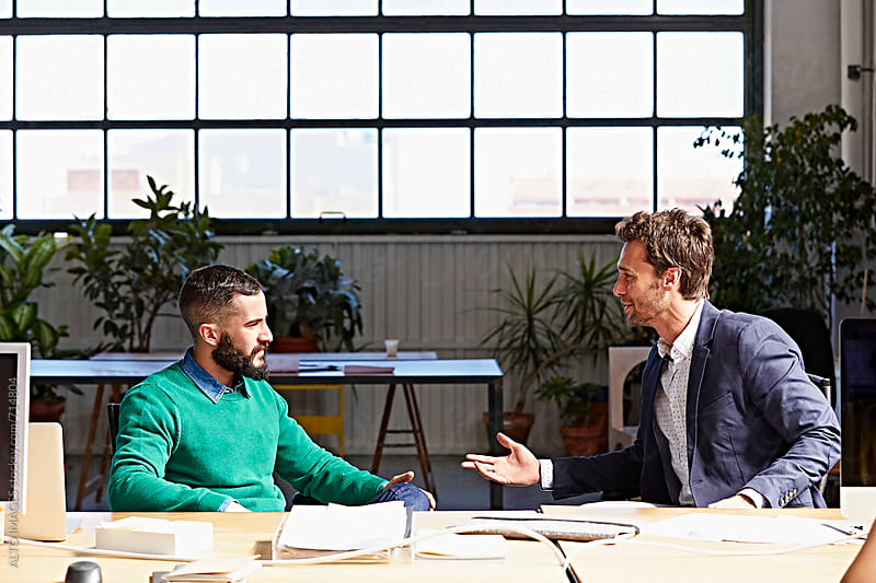 Businessmen Having Discussion In Office by ALTO IMAGES for Stocksy United