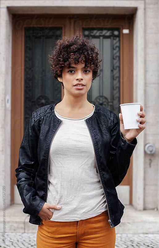 Portrait f young woman with to go coffee cup. by W2 Photography for Stocksy United