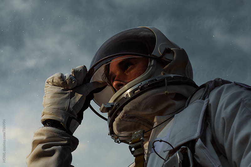 A heroic portrait of a young astronaut  by HOWL for Stocksy United