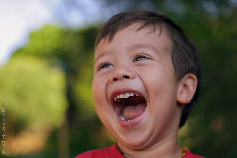 Little Boy having a big Belly Laugh by Rowena Naylor for Stocksy United