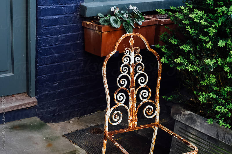 Old Rusty Metal Chair in Front of the House by Katarina Radovic for Stocksy United