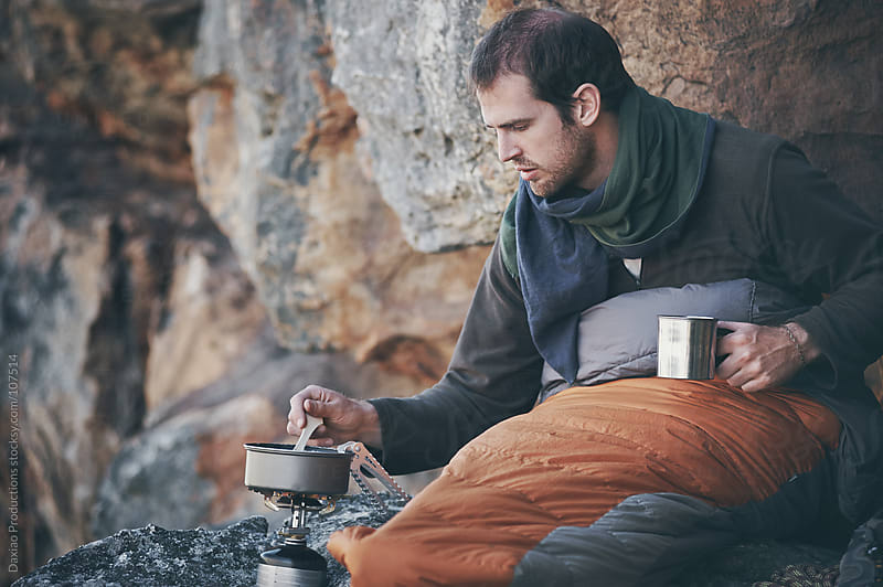 wilderness camping man by Daxiao Productions for Stocksy United