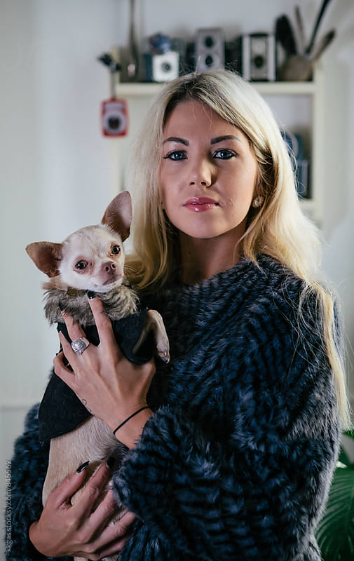 Blonde woman with Chihuahua dog. by kkgas for Stocksy United