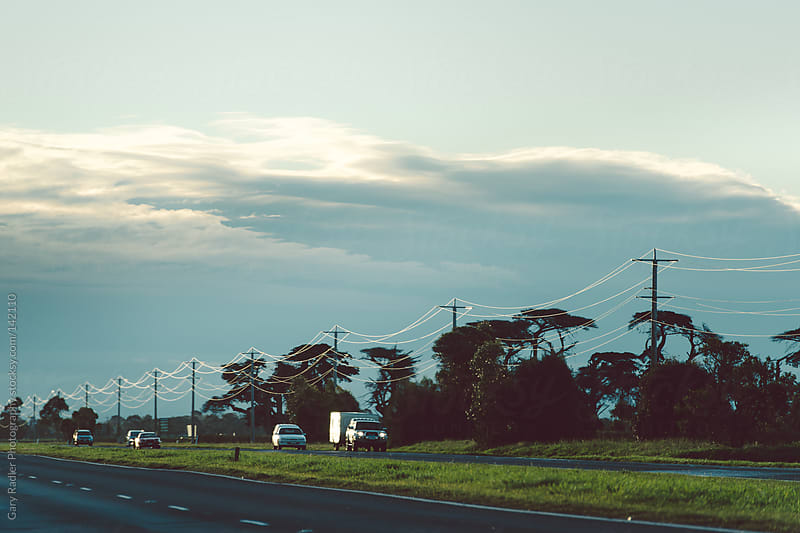 Cars on an Australian Highway at Dusk by Gary Radler Photography for Stocksy United