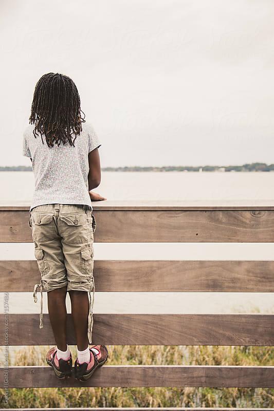 Girl on Boardwalk by Gabriel (Gabi) Bucataru for Stocksy United