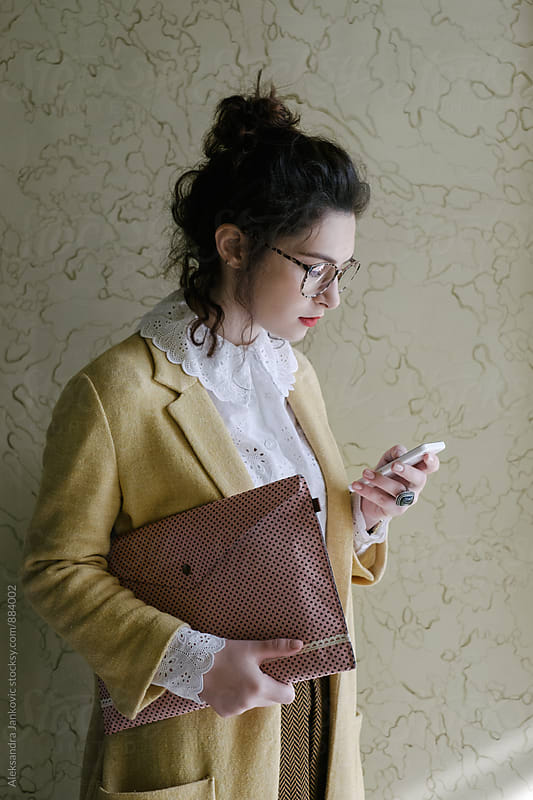 Young Stylish Businesswoman Using Phone by Aleksandra Jankovic for Stocksy United