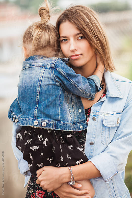 Mother embracing her 3 year old daugher by Irina Efremova for Stocksy United