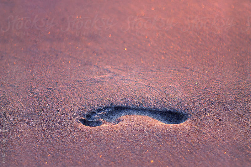 Footprint in the sand by Per Swantesson for Stocksy United