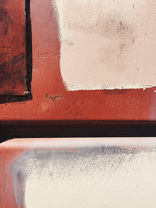 Detail of paint covering graffiti tags on metal wall by Paul Edmondson for Stocksy United