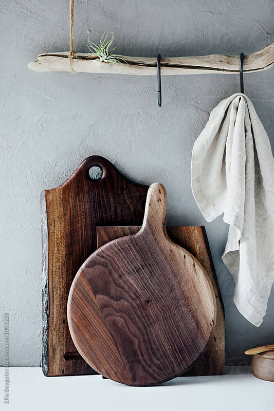 Cutting boards standing against the wall by Ellie Baygulov for Stocksy United