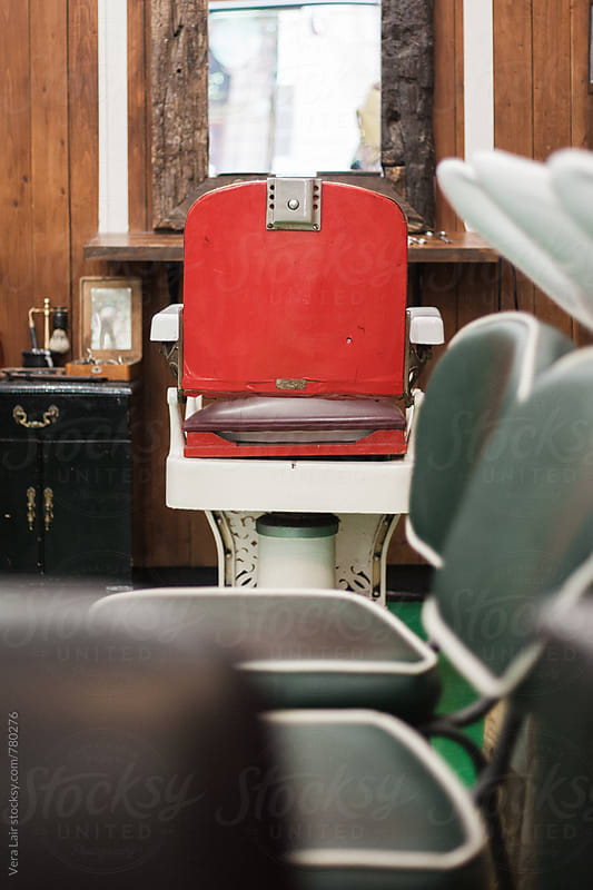 Vintage red barber armchair by Vera Lair for Stocksy United