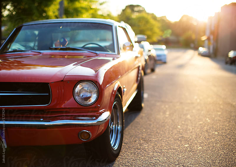 A vintage american muscle car parked on the street by Jakob for Stocksy United