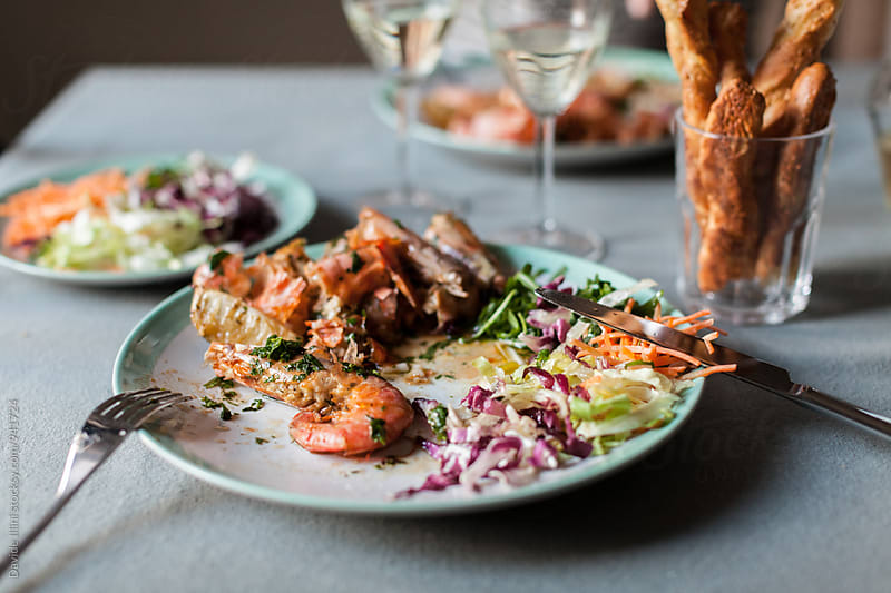 Roasted shrimp with salad by Davide Illini for Stocksy United