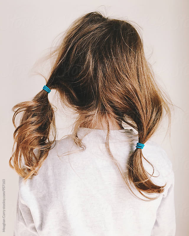 little girls's messy hair at the end of the day by Meaghan Curry for Stocksy United