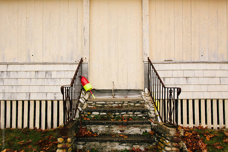 Lobster Buoy on Steps Maine by Raymond Forbes LLC for Stocksy United