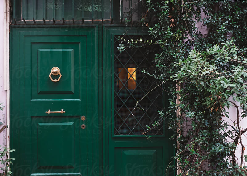 Green Door and Tree in Front of the House by Katarina Radovic for Stocksy United