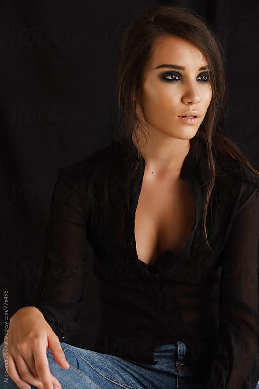 Studio portrait of a beautiful brunette woman  by Aleksandra Kovac for Stocksy United