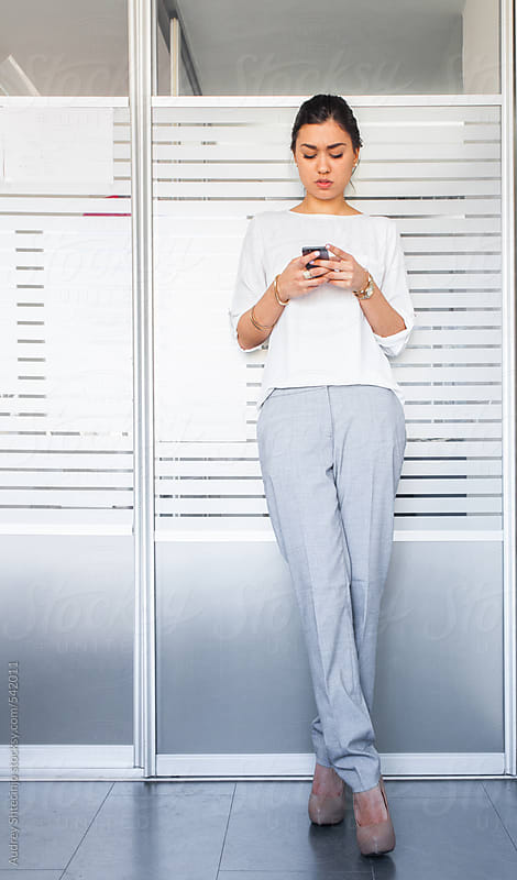 Successful young woman  in her office. by Audrey Shtecinjo for Stocksy United