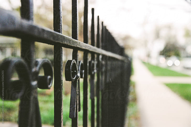 Wrought iron fence on a street by Gabriel (Gabi) Bucataru for Stocksy United
