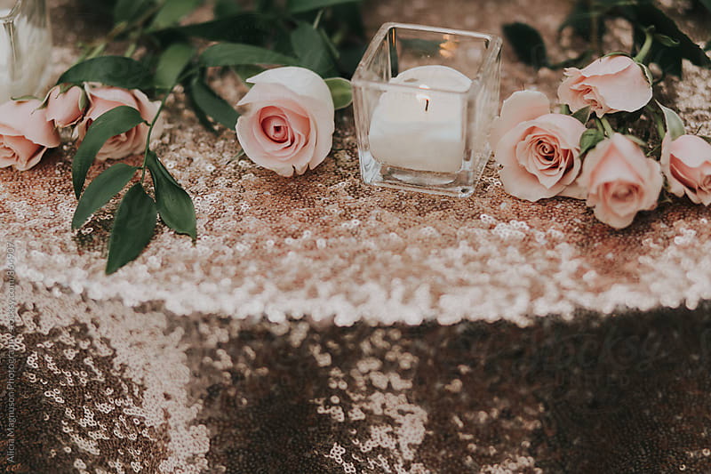 Detail of Pink Sequined Candlelit Table with Roses by Alicia Magnuson Photography for Stocksy United