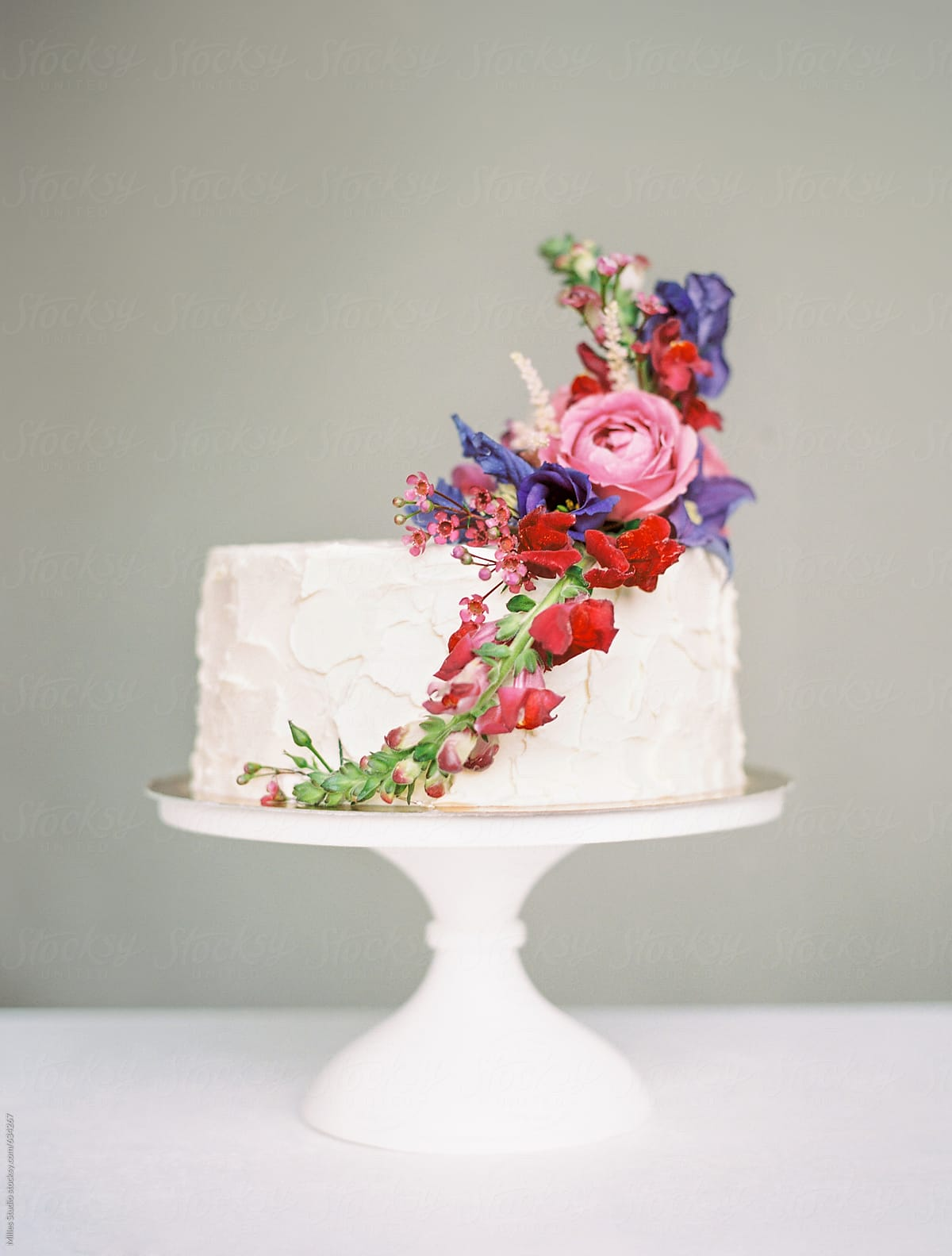 White Cream Layer Cake With Fresh Flowers Stocksy United