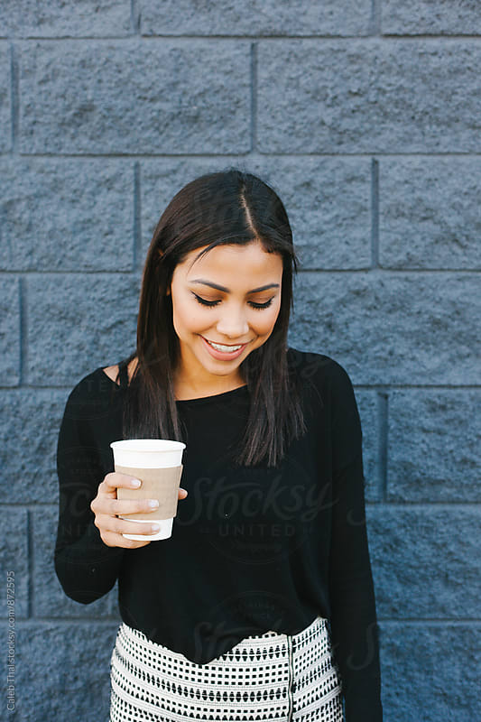 A Pretty Girl Holding Coffee by Caleb Thal for Stocksy United