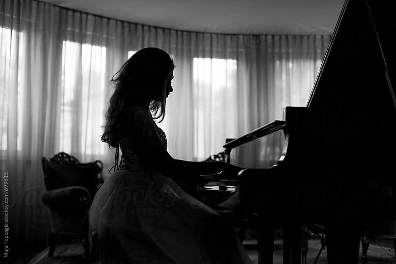 Young, beautiful and talented piano player Naomi  by Maja Topcagic for Stocksy United