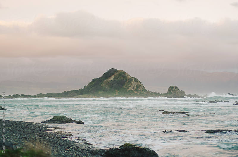 Stormy island during sunset by Dominique Chapman for Stocksy United