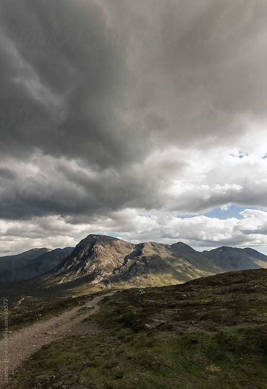 dramatic scenery in the scottish highlands by Leander Nardin for Stocksy United
