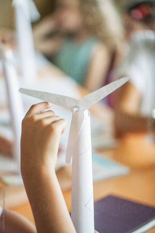 Students Making Paper Windmills by Lumina for Stocksy United