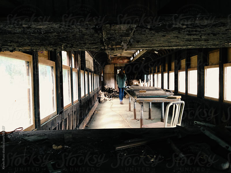 Woman In Abandoned Train Car by Kevin Russ for Stocksy United