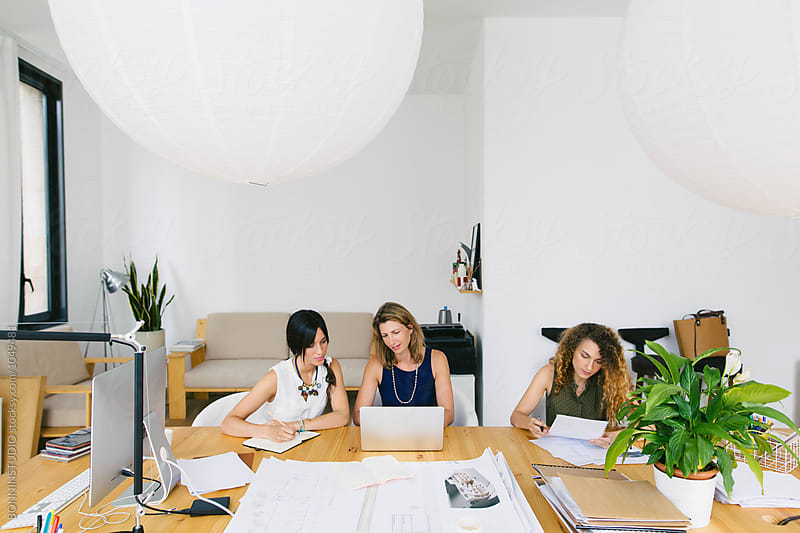 Female designer team working in a beautiful studio.  by BONNINSTUDIO for Stocksy United