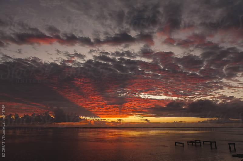 Tahitian sunset. by Robert Zaleski for Stocksy United